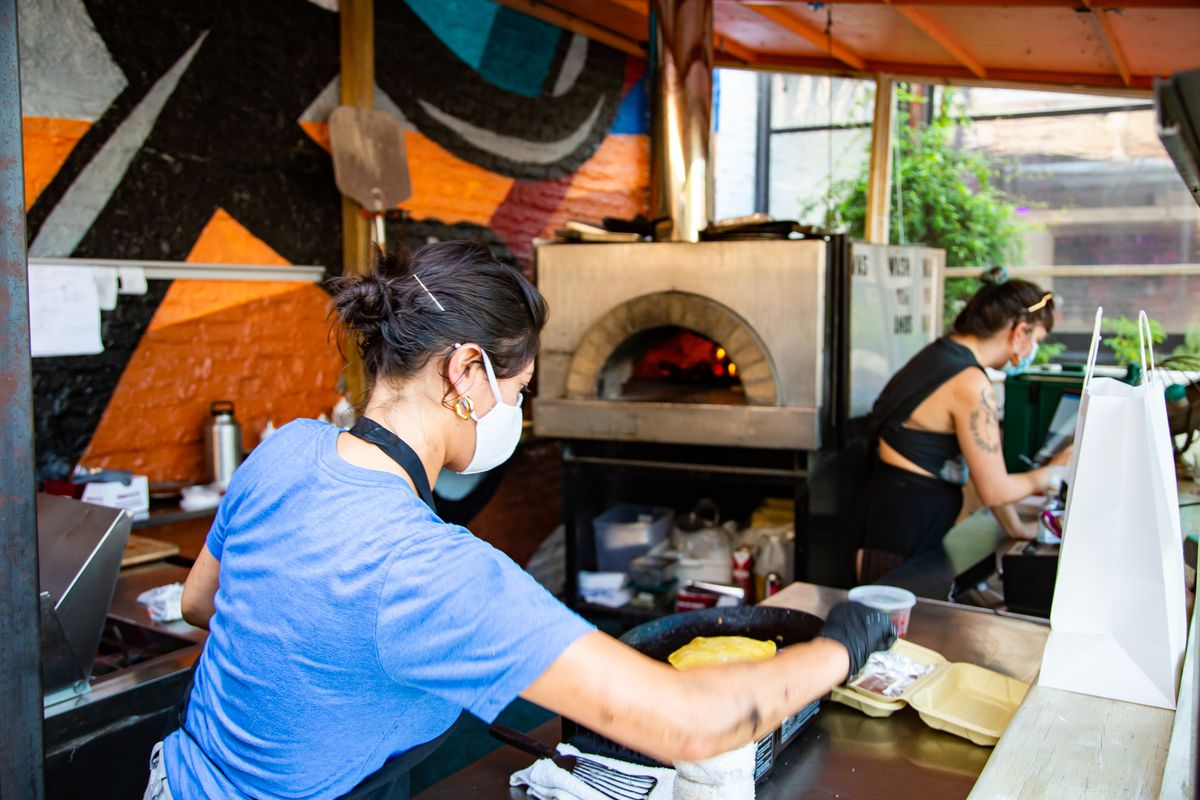 Chef Maricela Vega in the outdoor kitchen at Sidepiece in Atlanta