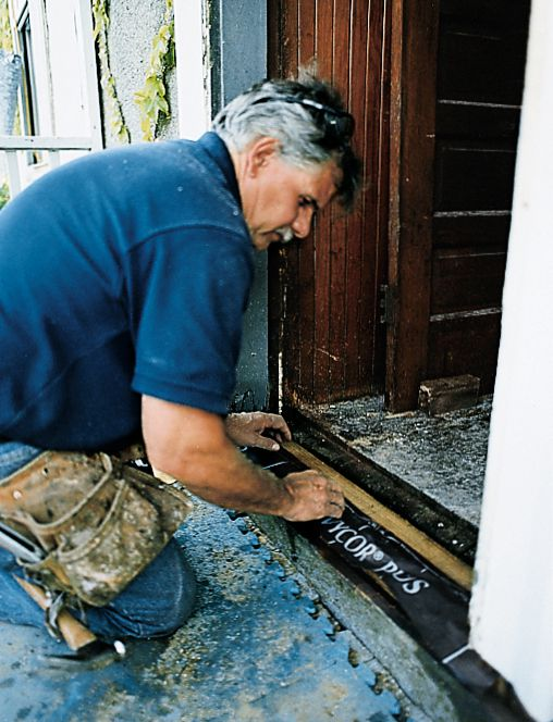 Man Adds Rubber Seal Between Jambs On Threshold