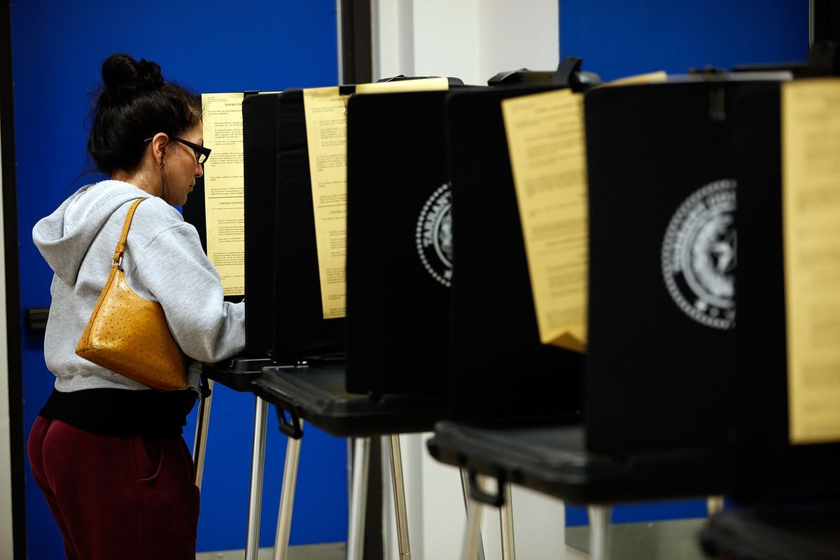A woman votes on Election Day 2012.