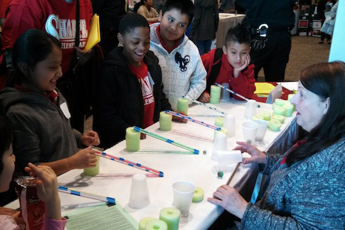 Sharpe Elementary students participate in a motion lesson from Cindy the Science Lady on Saturday during Shelby County Schools Family and Community Fair at the Salvation Army Kroc Center.