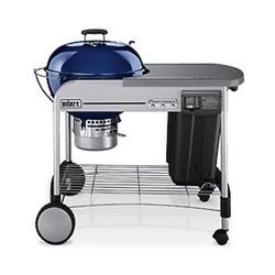 """Weber Performer Platinum: $369 """"While the Weber Performer Platinum looks like the same grill that's been in backyards since the Johnson administration, it combines the ease of gas with the flavor of charcoal. One press of the propane starter gets the fir"""