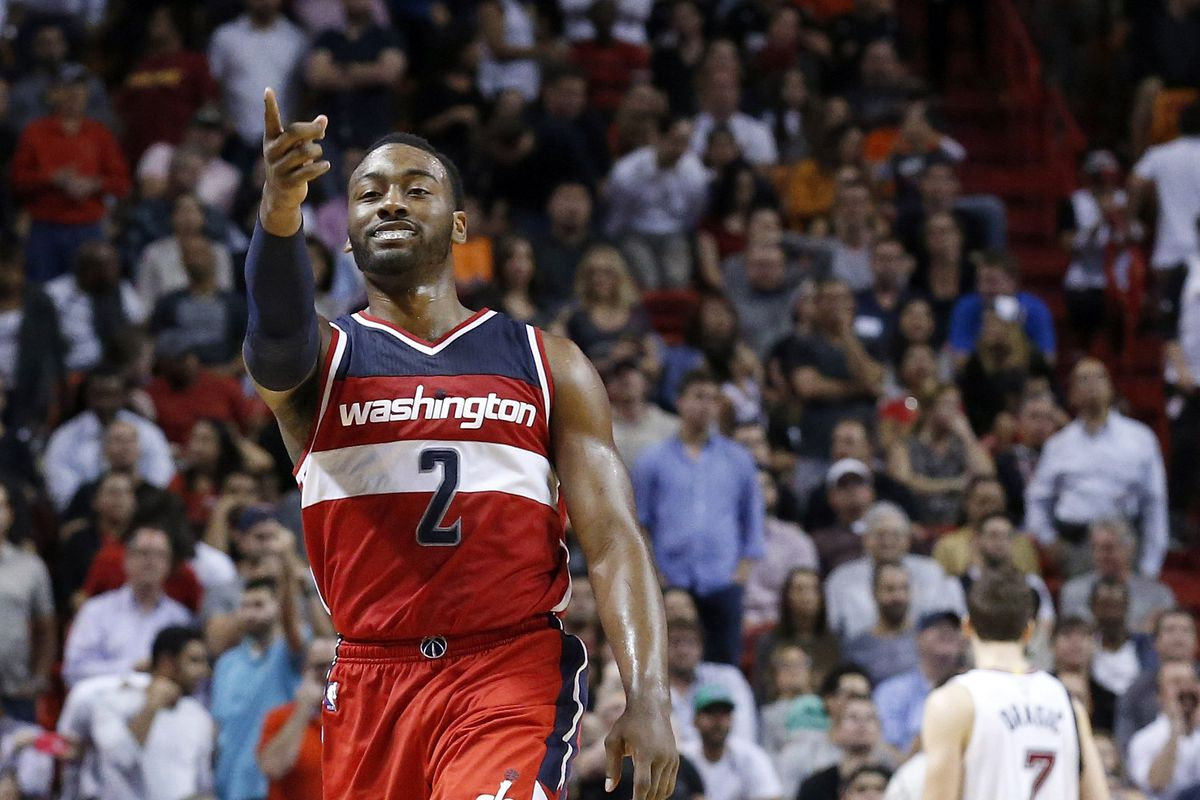 John Wall is on fire right now...