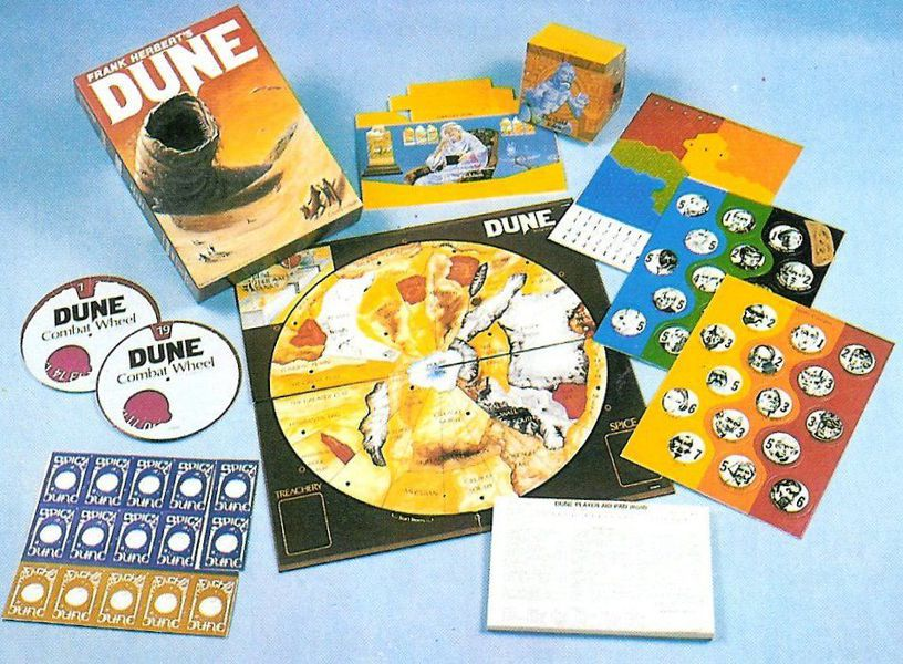 The colorful game components that came with the original version of Frank Herbert's Dune board game. They also include a circular map, combat wheels, and privacy screens just like the modern version.