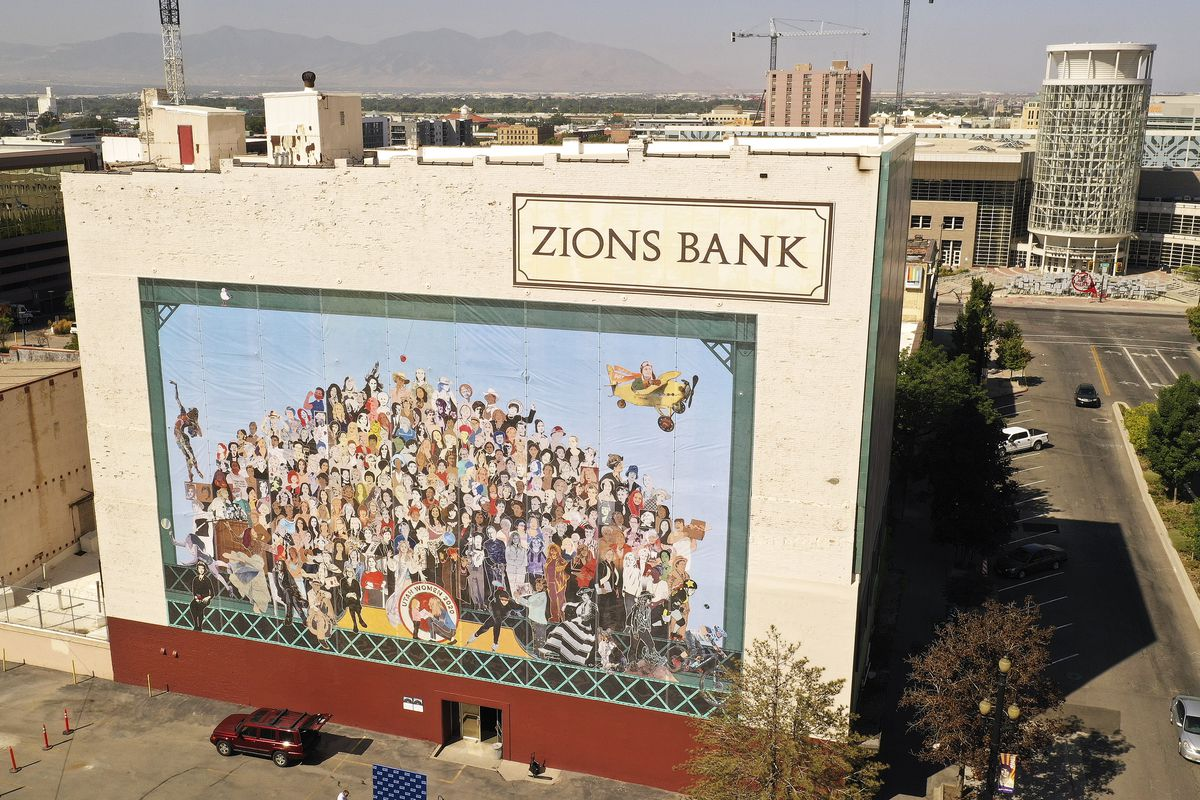 """The """"Utah Women 2020"""" mural on the Dinwoodey Building in Salt Lake City is pictured after its unveiling on Wednesday, Aug. 26, 2020. The mural, commissioned by Zions Bank in honor of women's suffrage, depicts images of 250 Utah women past and present."""