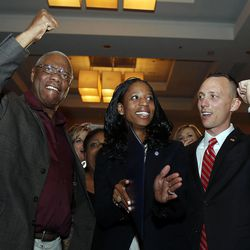 Mia Love, 4th Congressional District Republican candidate, declares victory on election night in Salt Lake City, Tuesday, Nov. 4, 2014. At left is her father, Maxime Bourdeau. At right is her husband, Jason.