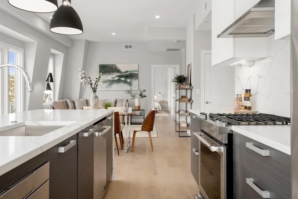 Looking through an ultra-modern kitchen to the dining room.