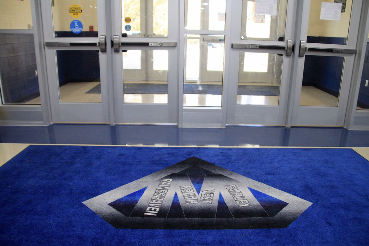 """The names Westhaven, Fairley and Raineshaven form a """"W"""" on the school's entrance mat."""