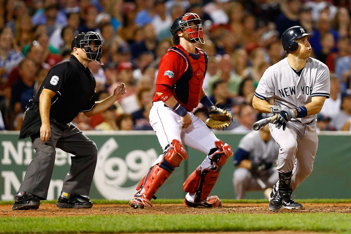 BOSTON, MA - JULY 06:  Mark Teixeira #25 of the New York Yankees hits a two run triple in the 7th inning against the Boston Red Sox during the game on July 6, 2012 at Fenway Park in Boston, Massachusetts.  (Photo by Jared Wickerham/Getty Images)