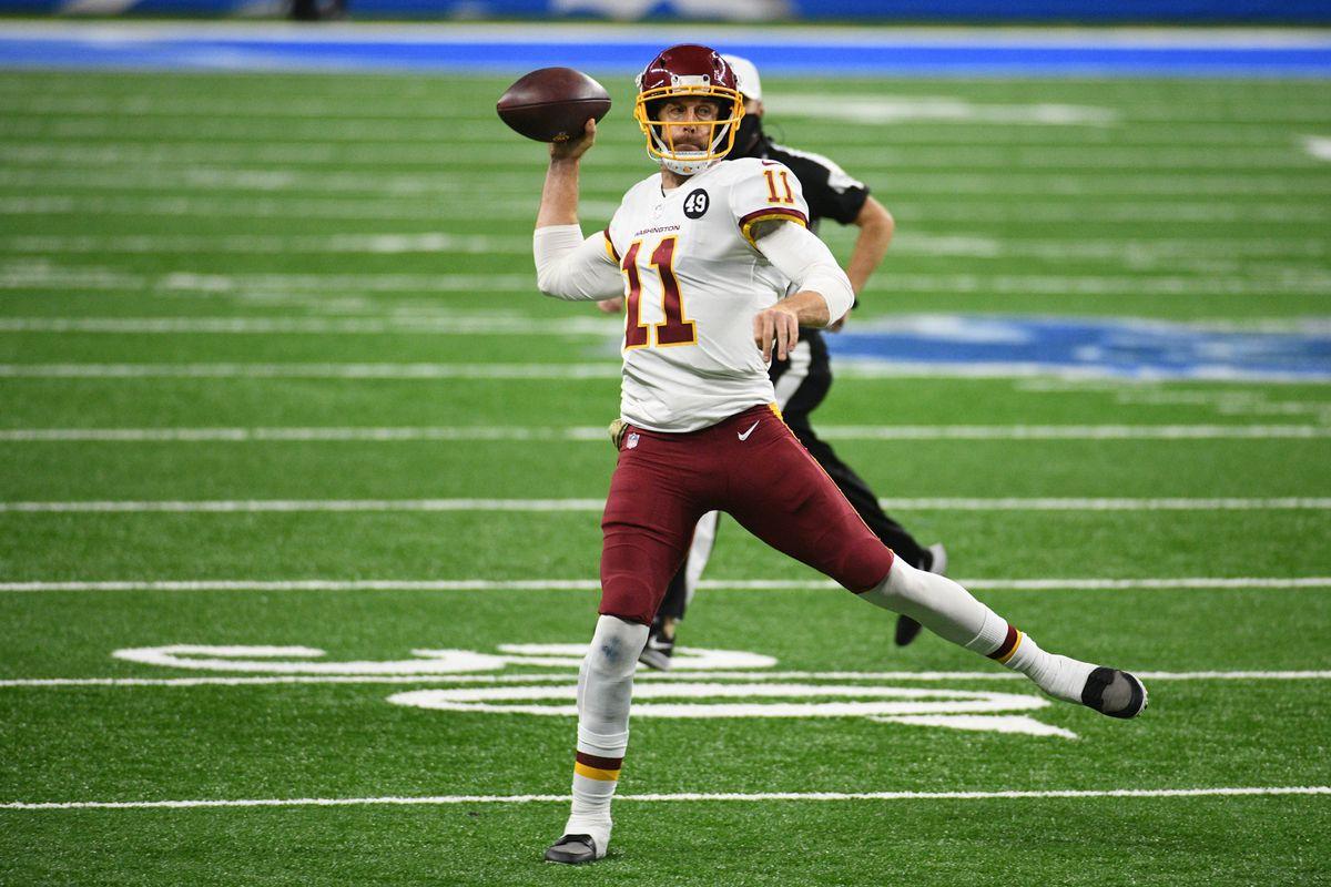 Washington Football Team quarterback Alex Smith (11) throws a pass against the Detroit Lions during the third quarter at Ford Field.