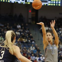 UConn's Kia Nurse (11) shoots a three-pointer during the Notre Dame Fighting Irish vs UConn Huskies women's college basketball game in the Women's Jimmy V Classic at the XL Center in Hartford, CT on December 3, 2017.