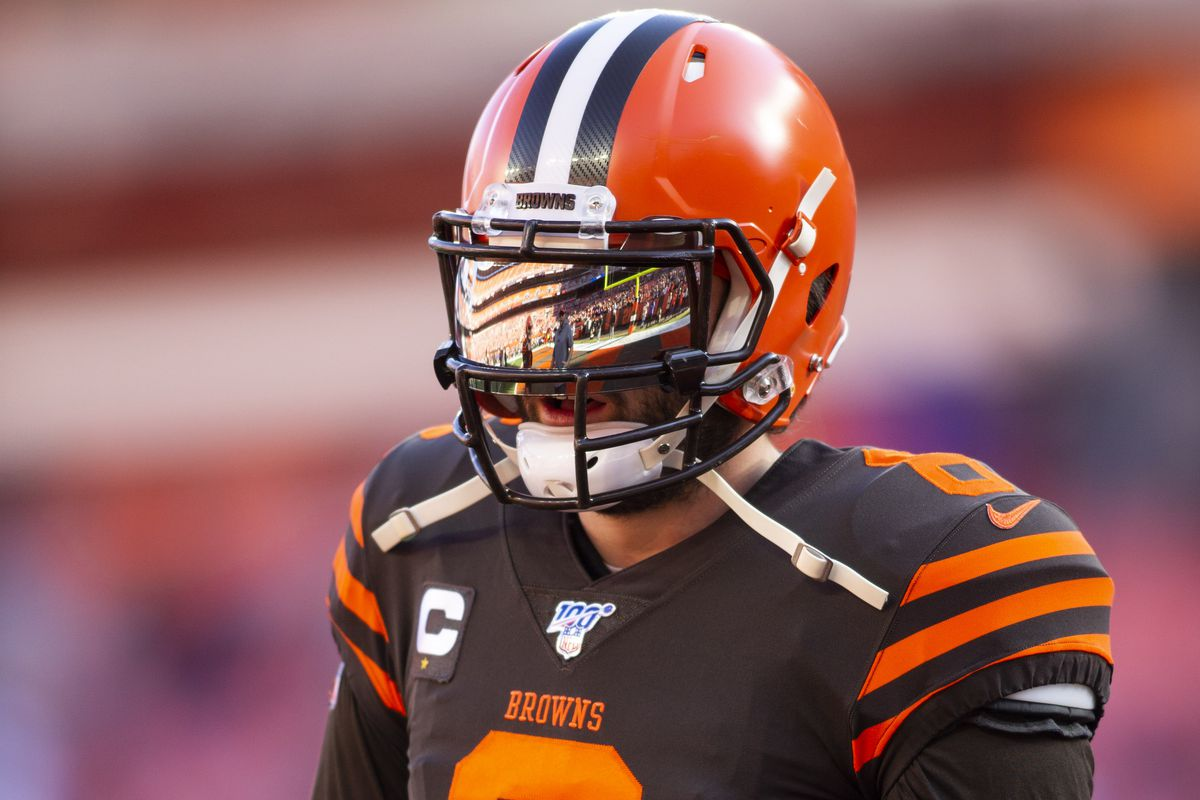 FirstEnergy Stadium is reflected in the visor of Cleveland Browns quarterback Baker Mayfield during warmups before the game against the Baltimore Ravens.