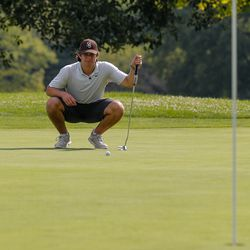 Mount Carmel's Christopher Whelton lines up a putt during practice at Jackson Park Golf Course.