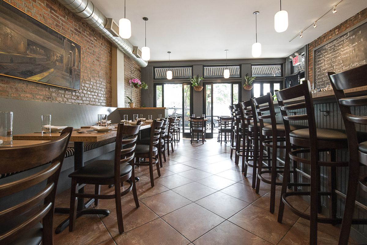 Shalom Japan's dining room with exposed brick walls