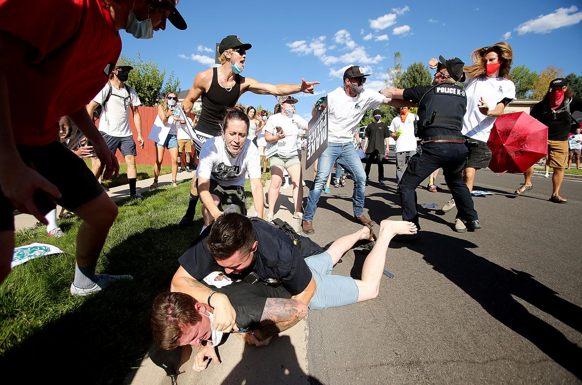Police and protesters collided in the streets of Cottonwood Heights on Sunday, Aug. 2, 2020. The group was marching on 6710 South when police blocked them at Cristobal Street and a confrontation ensued. Police said eight or nine protesters were arrested.