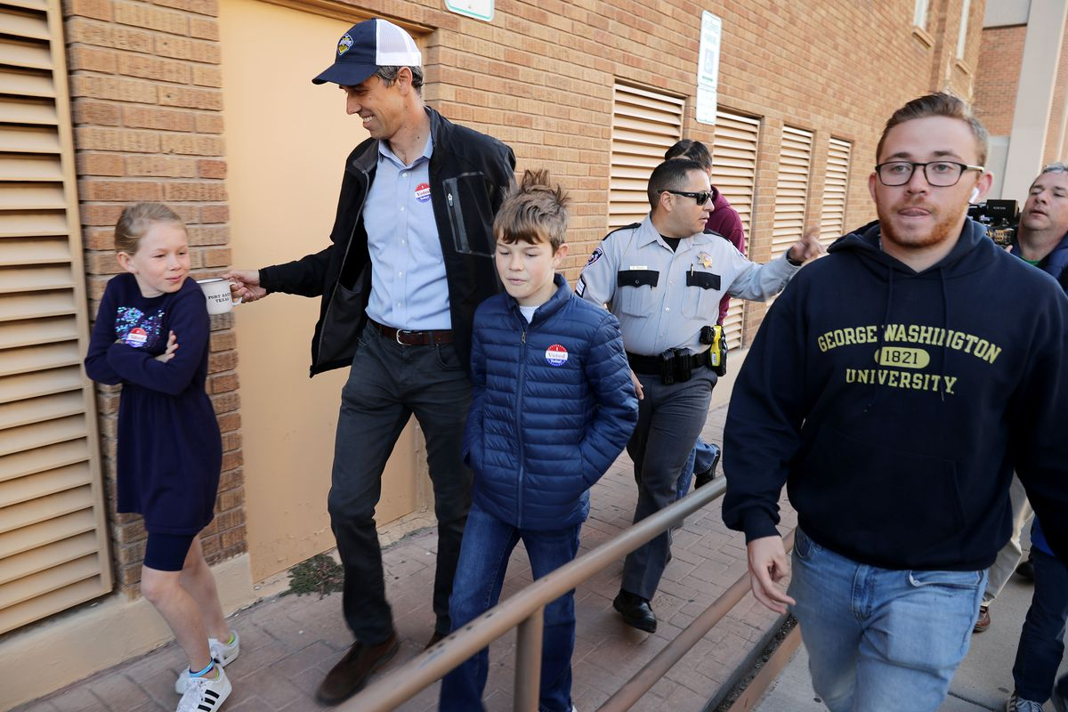 Beto O'Rourke and his children Molly (left) and Ulysses leave their neighborhood polling place after voting on November 6, 2018 in El Paso, Texas