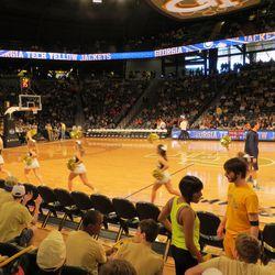 Cheerleaders Lead Team Onto Court