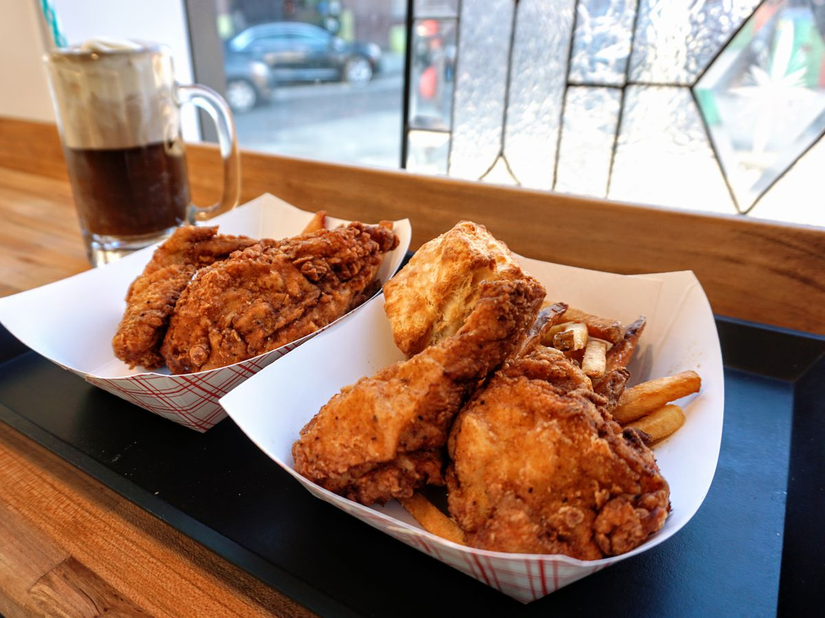 fried chicken in container on black tray