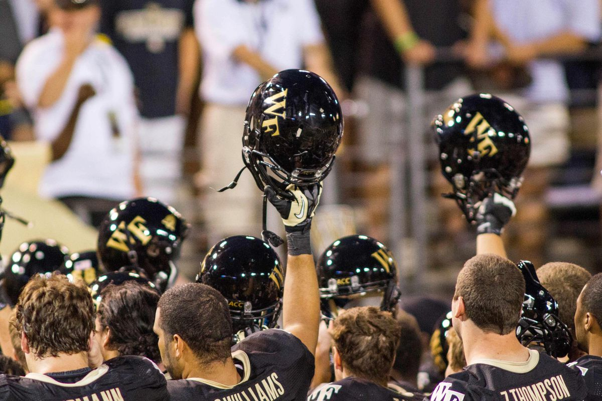 Sep 8, 2012; Winston Salem, NC, USA The Wake Forest Demon Deacons hold up helmets after defeating the North Carolina Tar Heels at BB&T field. Wake defeated the Heels 28-27.  Mandatory Credit: Jeremy Brevard-US PRESSWIRE