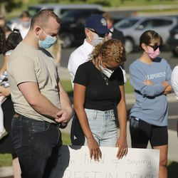 Protesters pray at the University of Utah Institute of Religion during a fast, march and prayer vigil for racial injustice in Salt Lake City on Sunday, June 14, 2020.