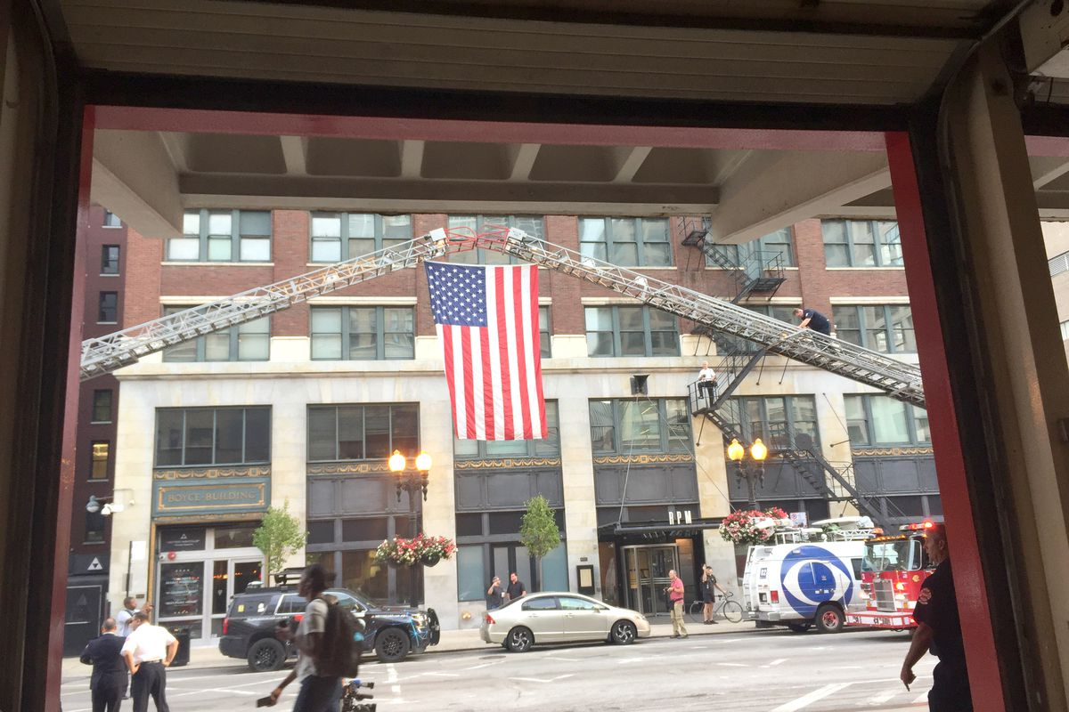 An American flag is displayed outside Chicago Fire Department Engine 42 fire station on Wednesday, Sept. 11, 2019.