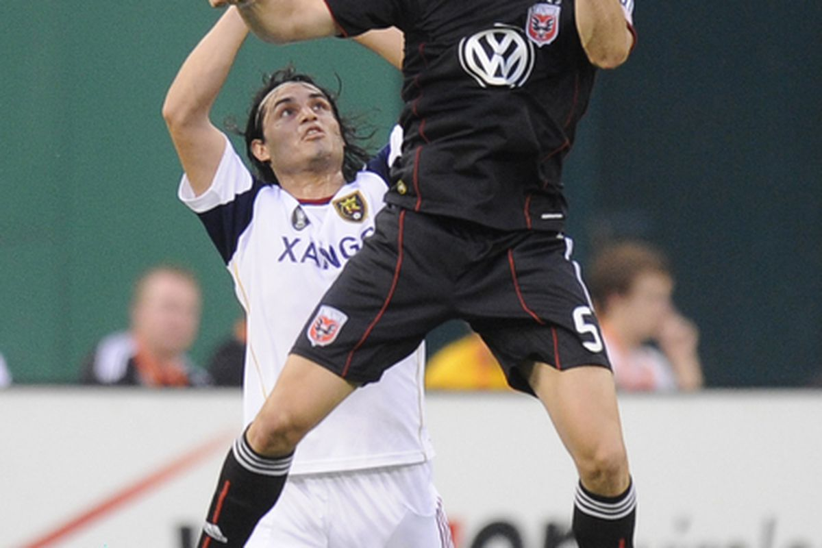 WASHINGTON - JUNE 5:  Marc Burch #4 of D.C. United heads the ball against Real Salt Lake during a MLS soccer match on June 5, 2010 at RFK Stadium in Washington D.C.  (Photo by Mitchell Layton/Getty Images)