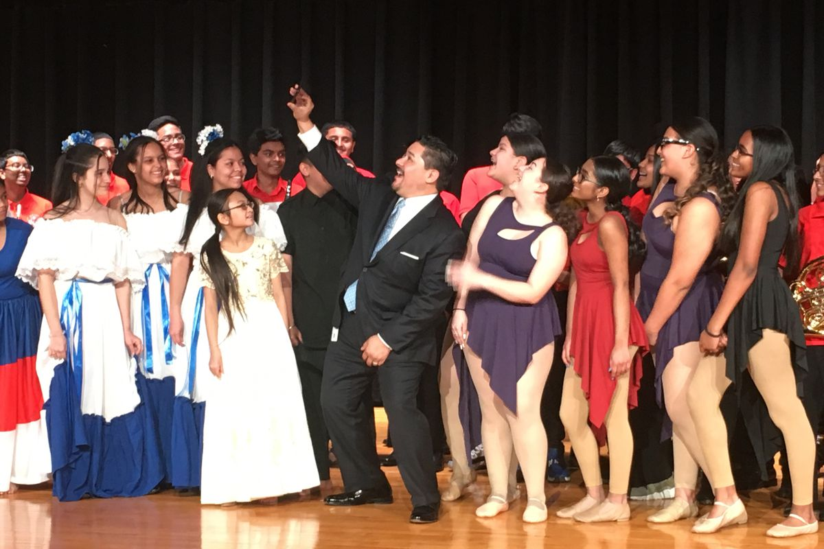 Chancellor Carranza takes a selfie with students from MS 137 America's School of Heroes.