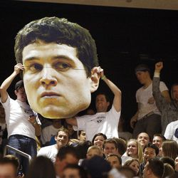 BYU fans hold a huge enlargement of BYU guard Jimmer Fredette prior to the game with San Diego State in Provo on Jan. 26, 2011.