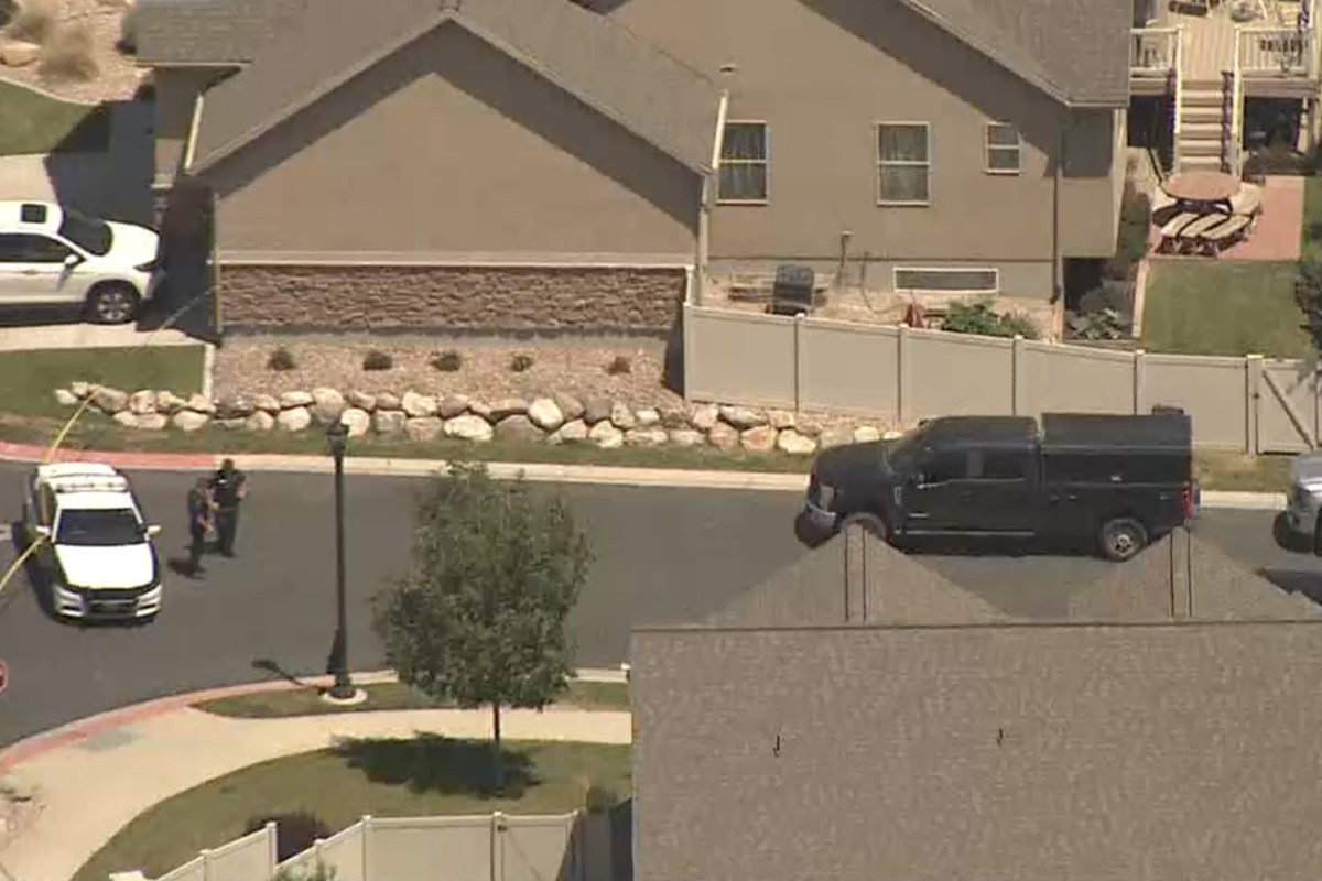 Police are seen Friday, July 24, 2020, at the scene where explosives were found in a South Jordan home following an hourslong standoff that started the night before.