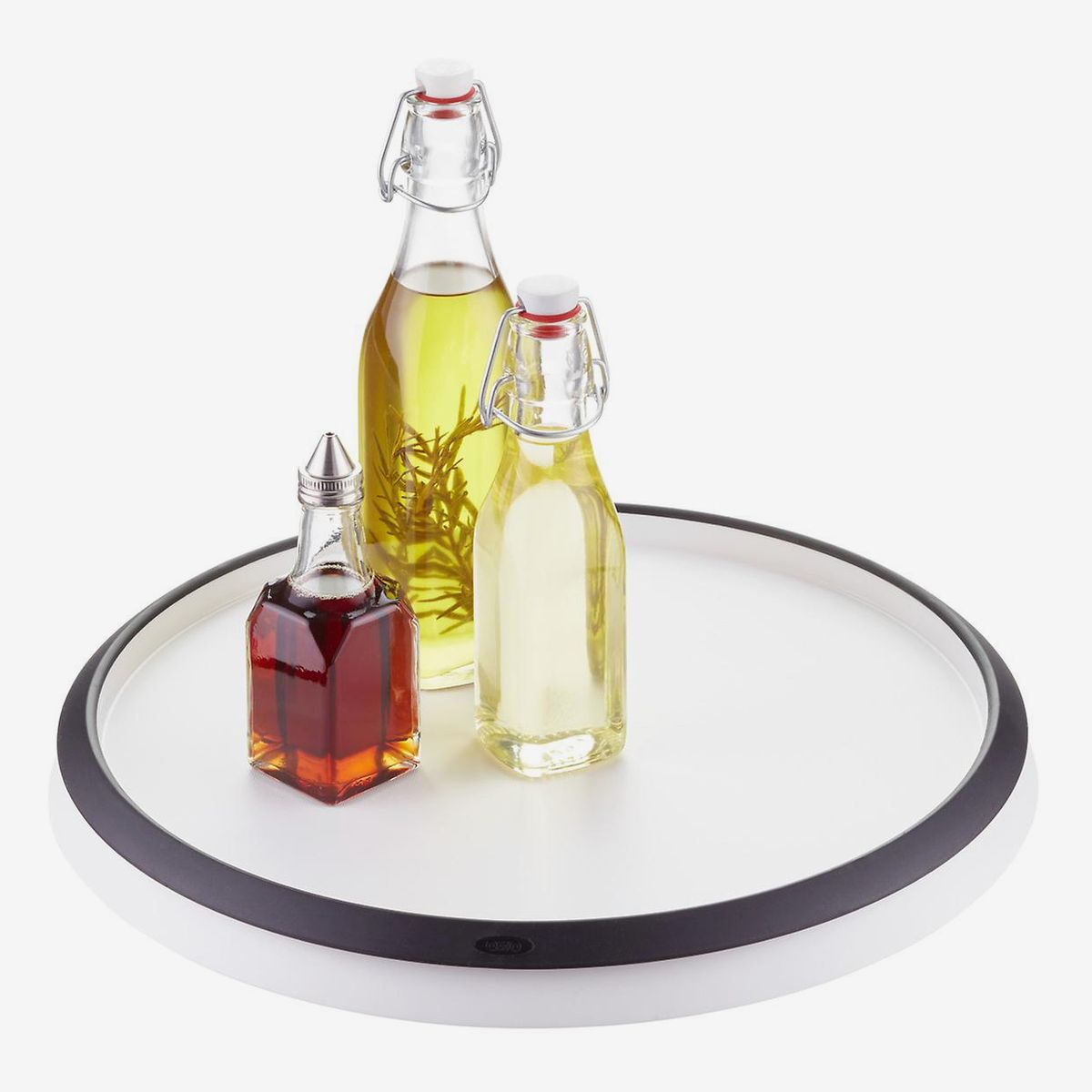 A Lazy Susan with three glass bottles of assorted oils