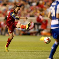 """Real Salt Lake midfielder Ned Grabavoy (20) shoots at the goal as the Real Salt Lake plays FC Dallas in MLS soccer, Saturday, Sept. 6, 2014, in Sandy.  <img src=""""http://beacon.deseretconnect.com/beacon.gif?cid=234840&pid=83"""" />"""