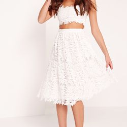 If you're not afraid to show a little skin, consider a cropped lace number paired with a matching high-waisted skirt.