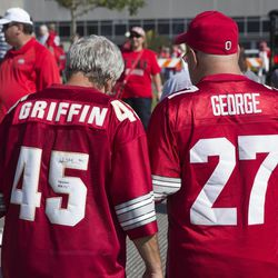 Tom Wenrick of Tipp City , Ohio (left) and Dan Zoeller of Cincinnati wear jerseys honoring Ohio State Buckeyes former Heisman Trophy winners Archie Griffin and Eddie George before the game against the Buffalo Bulls at Ohio Stadium.