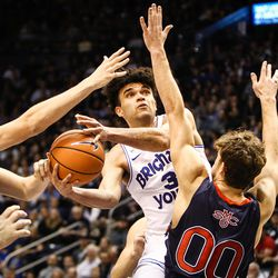 Brigham Young Cougars guard Elijah Bryant (3) wheels a shot against St. Mary's Gaels guard Tanner Krebs (00) and St. Mary's Gaels center Jock Landale (34) as the BYU Cougars take on the Saint Mary's Gaels in the Marriott Center in Provo on Saturday, Dec. 30, 2017.