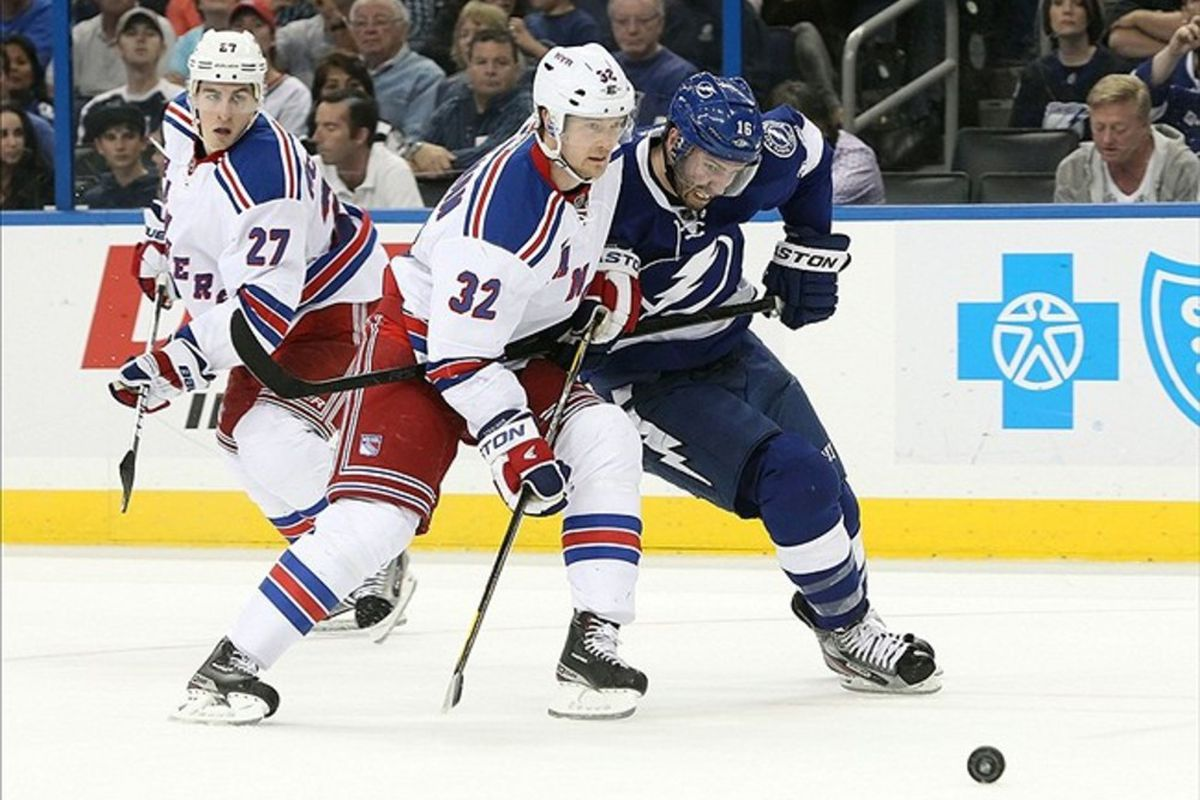 March 2, 2012; Tampa FL, USA; New York Rangers defenseman Anton Stralman (32) defends Tampa Bay Lightning right wing Teddy Purcell (16) during the second period at Tampa Bay Times Forum. Mandatory Credit: Kim Klement-US PRESSWIRE