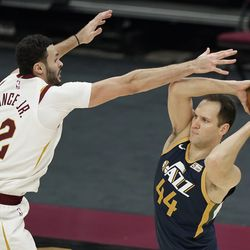 Utah Jazz's Bojan Bogdanovic (44) looks to pass over Cleveland Cavaliers' Larry Nance Jr. (22) in the second half of an NBA basketball game, Tuesday, Jan. 12, 2021, in Cleveland.