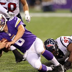 Aug 9, 2013; Minneapolis, MN, USA; Minnesota Vikings quarterback James Vandenberg (6) gets sacked by Houston Texans defensive tackle Terrell McClain (97) in the second half at the Metrodome. The Texans won 27-13.