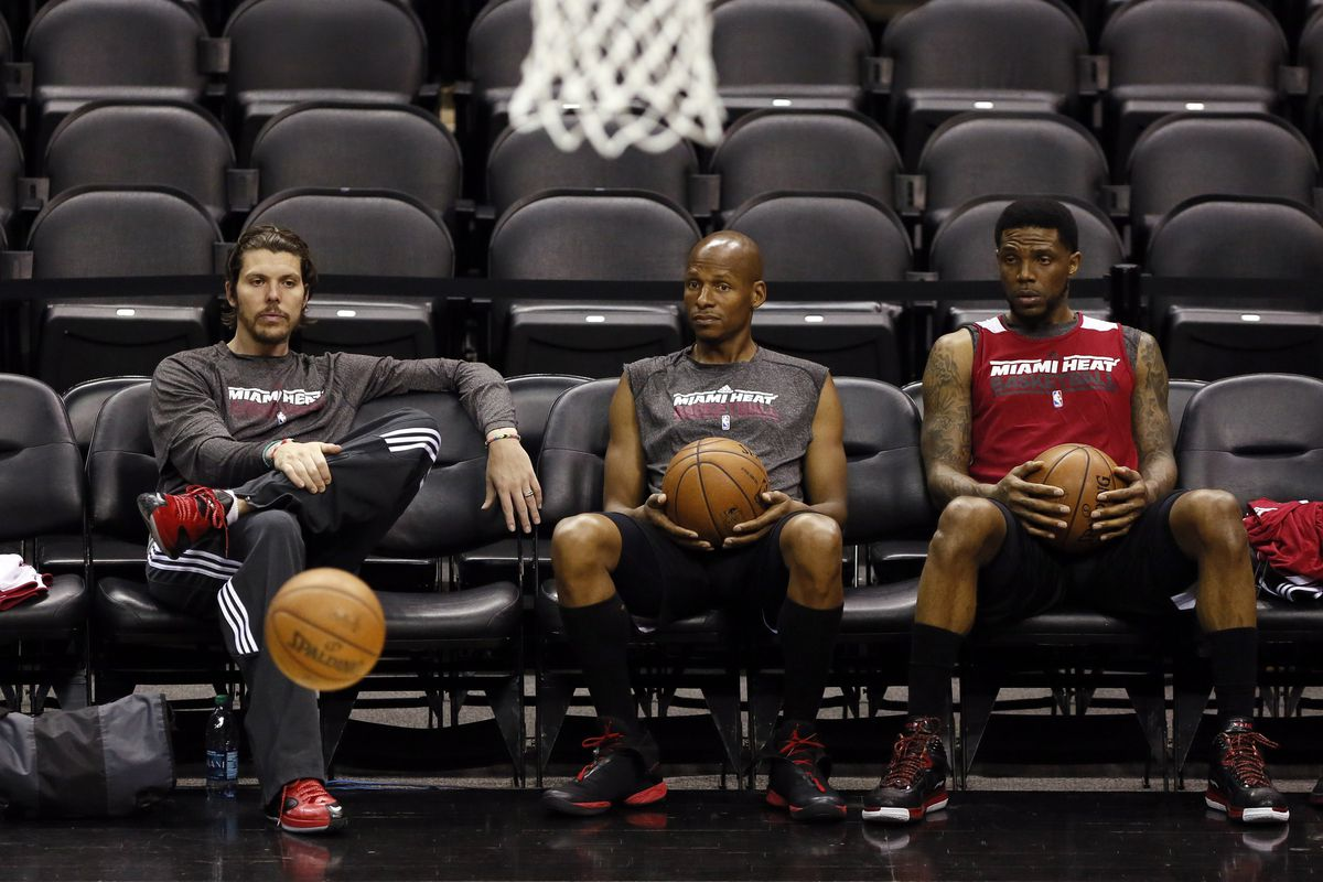 I like that this picture makes it look like Miller is levitating a basketball, while Allen and Haslem watch, awed.