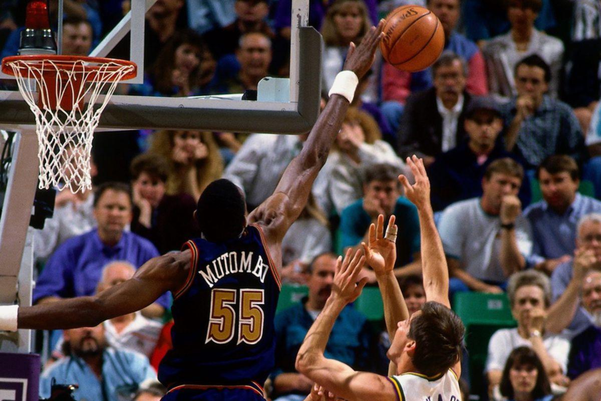 Dikembe Mutombo swatting Jeff Hornacek during the 1994 Semi-Finals Game 5