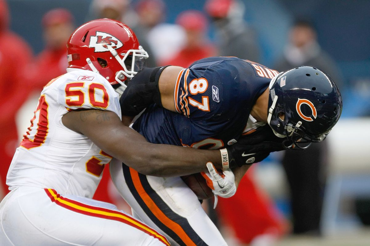 CHICAGO, IL - DECEMBER 4: Justin Houston #50 of the Kansas City Chiefs tackles Kellen Davis #87 of the Chicago Bears at Soldier Field on December 4, 2011 in Chicago, Illinois. The Chiefs defeated the Bears 10-3. (Photo by Scott Boehm/Getty Images)