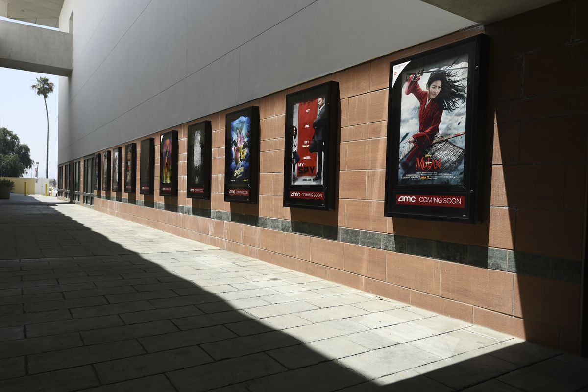 Posters for upcoming movies are displayed in an empty corridor at the currently closed AMC Burbank Town Center 8 movie theaters complex on April 29, 2020, in Burbank, Calif. AMC Entertainment lost billions during the pandemic.