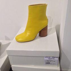 Maison Martin Margiela boots: $970