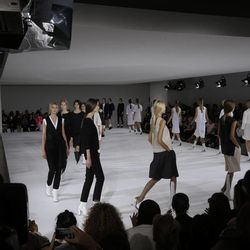 Models wear creations part of the Jil Sander women's Spring-Summer 2013 collection that was presented in Milan, Italy, Saturday, Sept. 22, 2012.