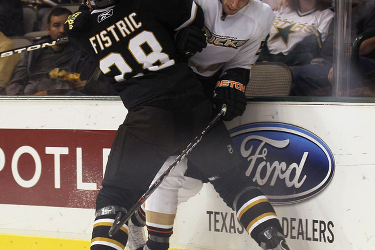 DALLAS - OCTOBER 26: Troy Bodie #50 of the Anaheim Ducks is hit by Mark Fistric #28 of the Dallas Stars at the American Airlines Center on October 26 2010 in Dallas Texas. (Photo by Bruce Bennett/Getty Images)