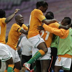 Ivory Coast's Gervais Yao Kouassi left, Didier Zokora, 2nd left, Didier Drogba, center, Moussa Kone, 2nd right, and Serge Deble, right, celebrate a goal  during an international  friendly soccer match between the national soccer teams of Ivory Coast and Israel at the Stade de Geneve stadium in Geneva, Switzerland, Wednesday, August 10, 2011.