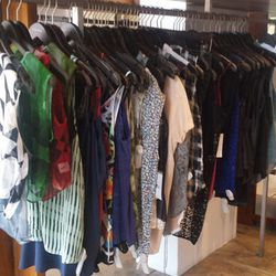 Blouses and tops by T by Alexander Wang, Bellerose, Helmut Lang, Lavender Brown, Parker and others ranging from $49  to $148 and up.