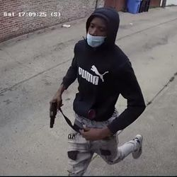 Surveillance photo of the person wanted for the alleged murder of two teens June 20, 2020, in South Chicago.