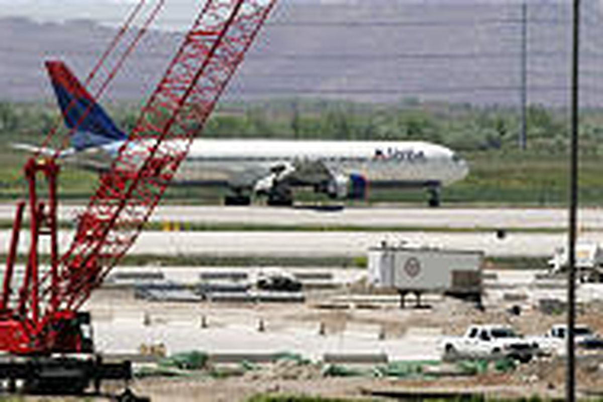 A Delta jet lands at Salt Lake Airport. An analyst is predicting the airline's bankruptcy within weeks.