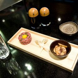 Wagyu beef tartare with raw quail egg, wonton chips and pickled baby daikon