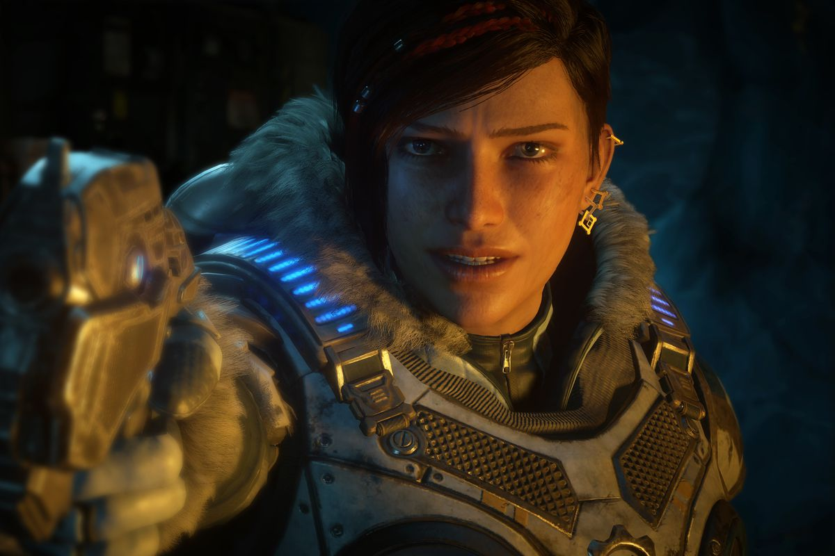 Kait aiming a pistol at the camera in Gears 5