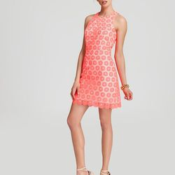 """Your bridesmaids can wear Lilly Pulitzer's <a href=""""http://www.lillypulitzer.com/product/Dresses/Wedding-Boutique/entity/pc/38/c/310/5668.uts?swatchName=Fiesta+Pink+Pinwheel+Organza"""">Pearl Shift</a> ($348) to the ceremony now and the country club later."""